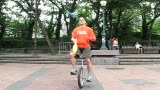 clubs on unicycle at City Hall